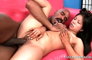 Sexy Asian puts black shaft in all fuck holes