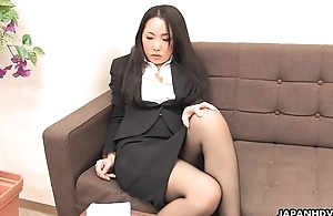 Asian office employee rubs her wet pussy up